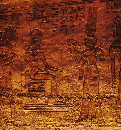 Nefertari offering sistrums to the seated goddess Hathor in the smaller temple at Abu Simbel.