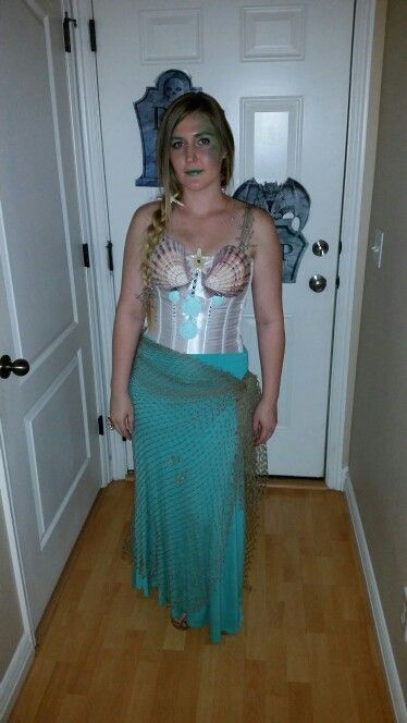 c65b6c6667b DIY Mermaid Halloween costume. Plain corset and hot glued on shells and  pearls and rhinestones. Maxi skirt with fish net a sarong for bottom