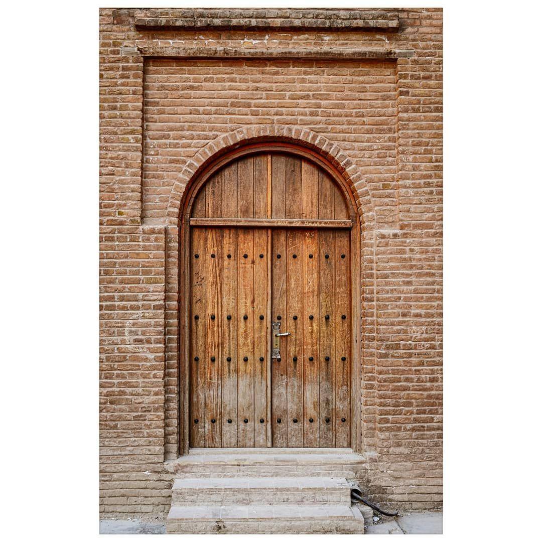 . Wooden door for brick wall. . . . . . . . . #yourshotphoto…