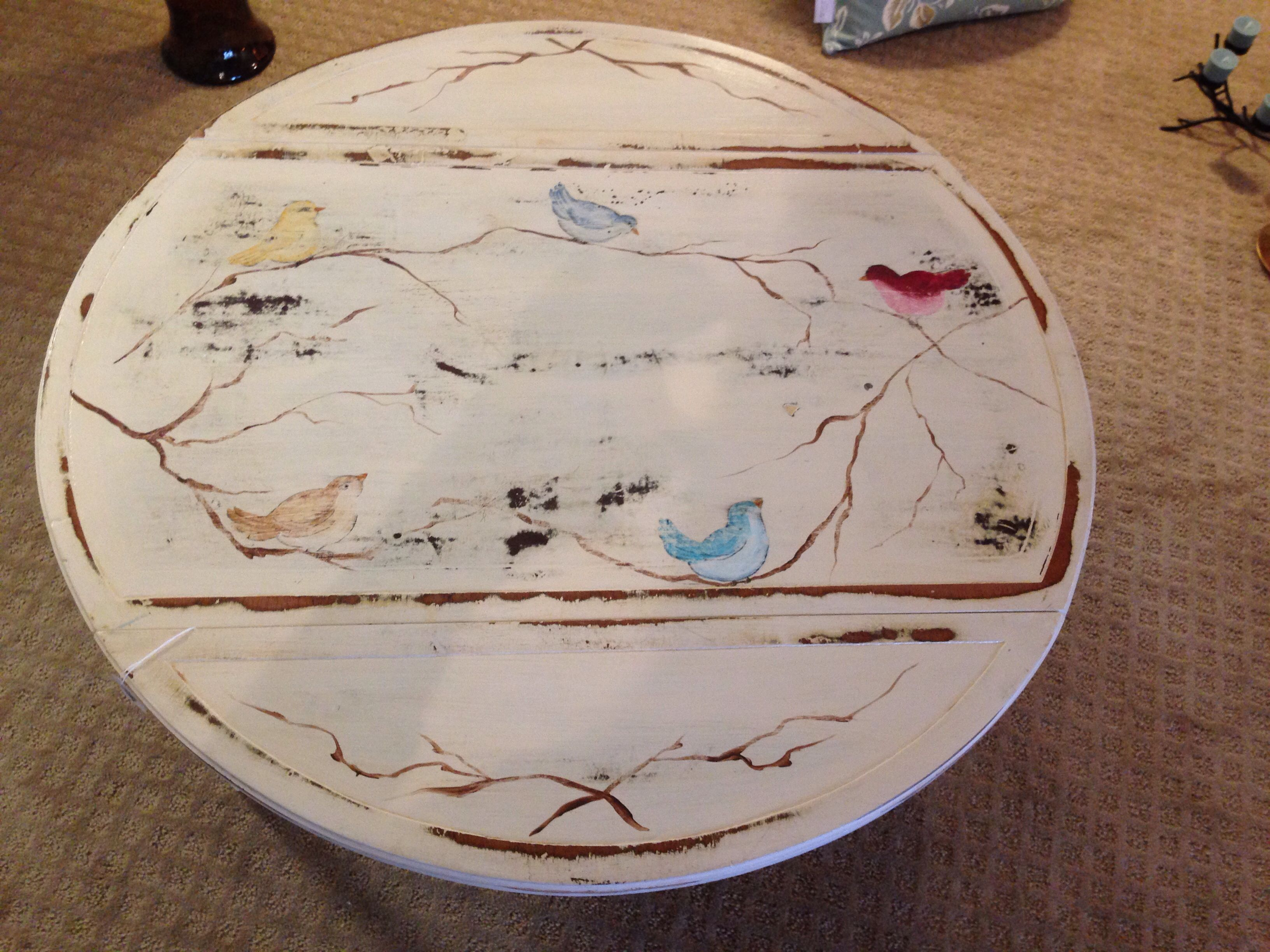 Small round coffee table with drop leaf sides Hand painted with