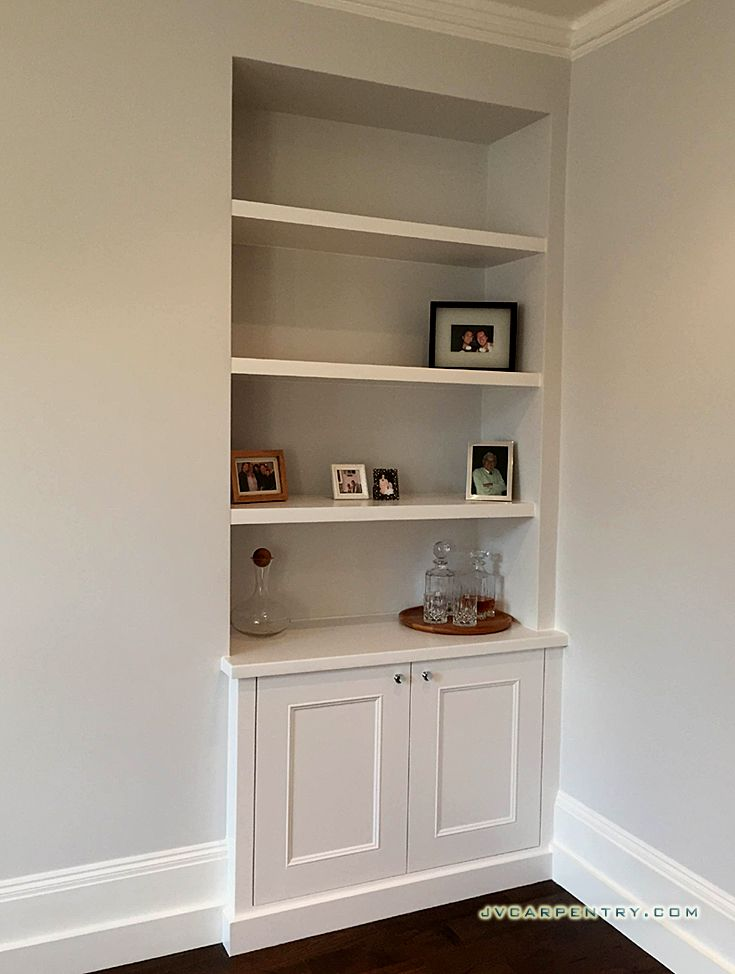 Alcove lower cupboards and floating shelves with LED strip