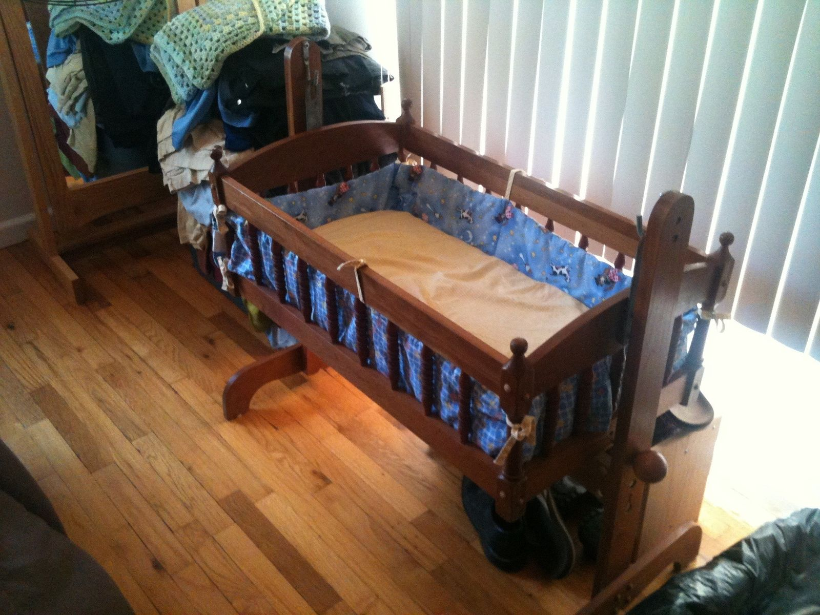 Classic Wooden Baby Cradle Design With Cool Blue Bedding Decorating Inspirations And Soft Beige Baby Mattress Acces Baby Cradle Wooden Baby Cradle Blue Bedding