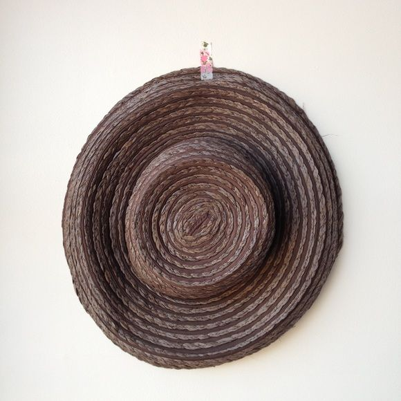 Perfect beach hat Brown straw hat. Lays flat it suitcase. Wide brim, very flattering. Accessories Hats