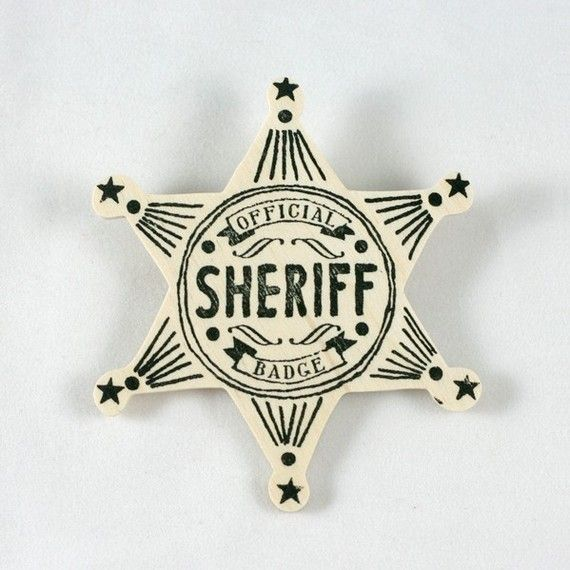 """There are those days when we all need to grab our boot straps and pony up to the task at hand. For those days, you need this badge! Tell them all you mean business and it's official. An official sheriff's badge perfect as a decorative accessory or for playtime fun. The natural wooden badge is individually stamped with our hand drawn badge design and heat sealed.  Details: Each badge measures about 3"""" wide and has a safety bar pin on the back."""