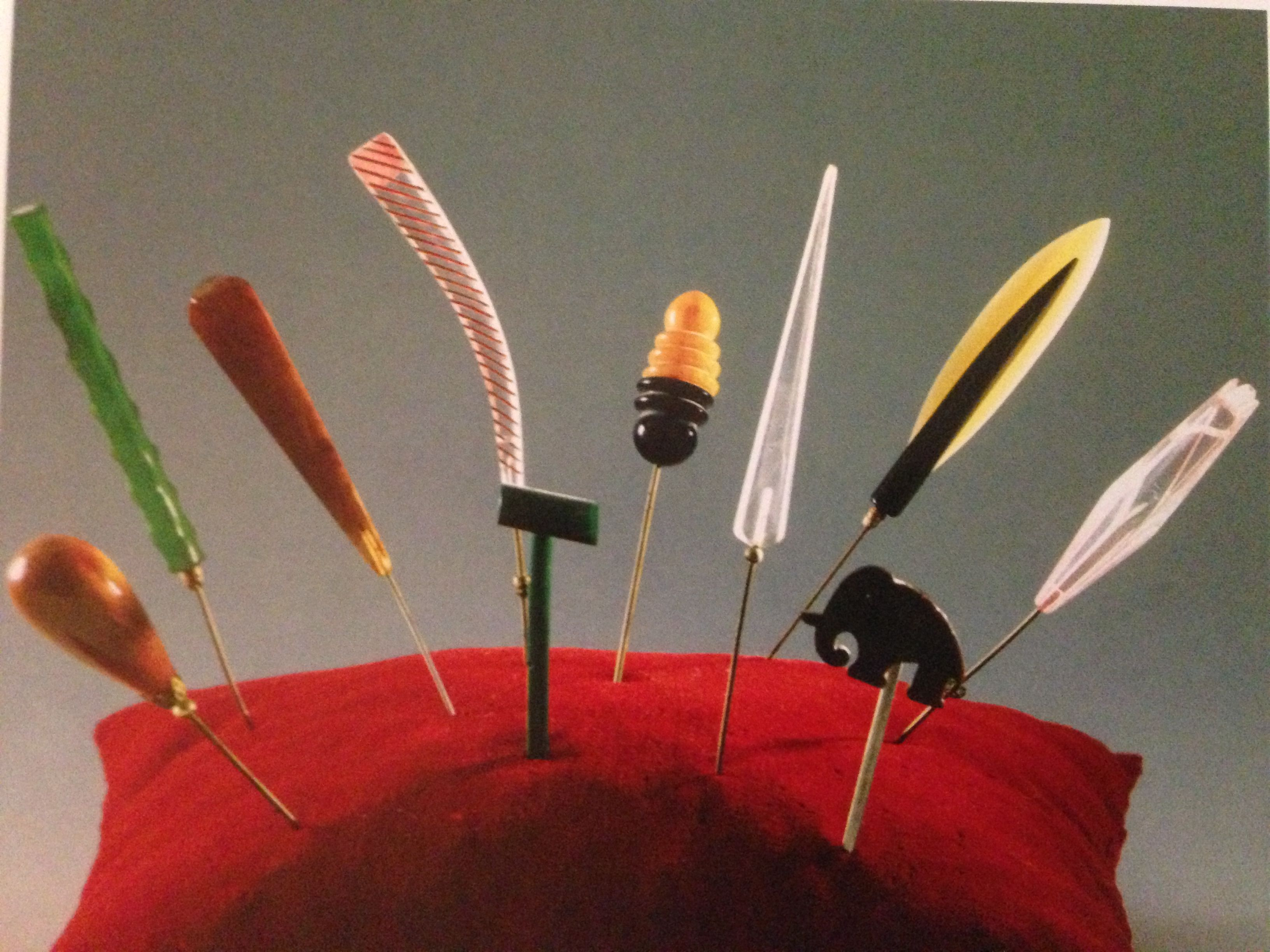 A selection of 1930s Art Deco hat pins with stylized plastic heads.