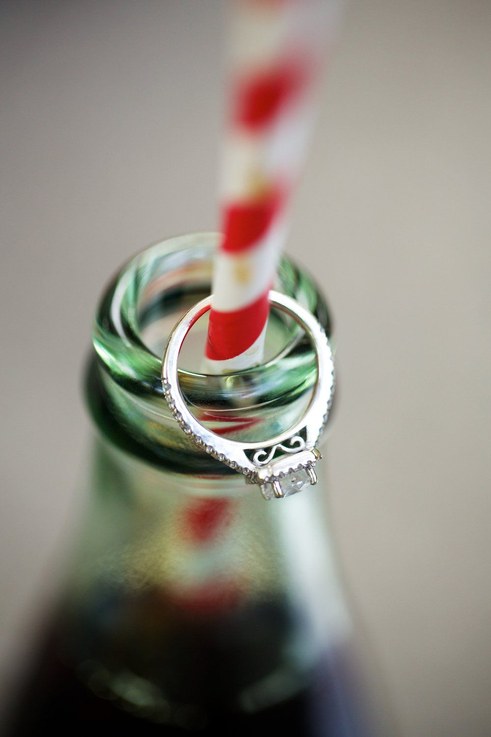 Wedding ring with an old fashioned coke and straw engagement