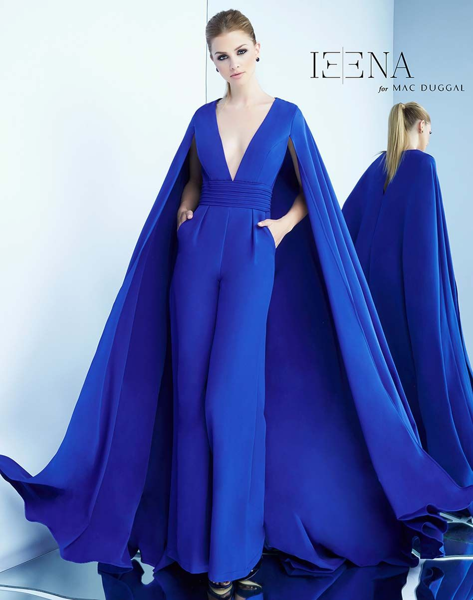 64460dc1bd Wide leg jumpsuit with plunging neckline, pleated waistband and floor  length cape, this jumpsuit is available in Royal Blue.