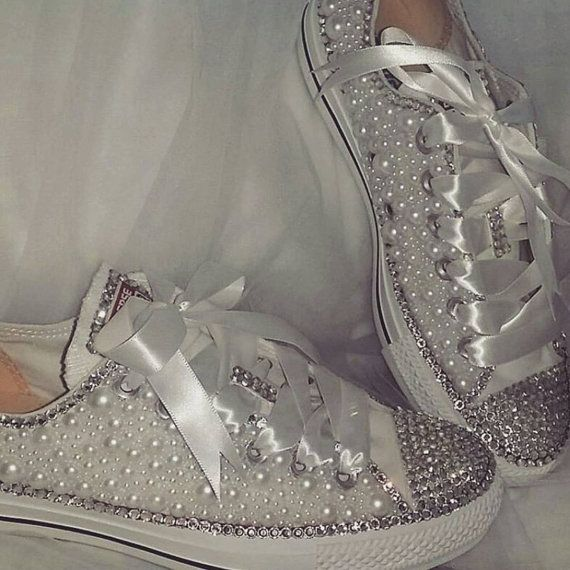 You are at the right stop for your perfect wedding shoes! For those who likes their comfort and style, here is a most loved All Star Converse beautifully decorated with Pearls and Diamantes / Rhinestones. This item is made to order, therefore, it can be done in any size as its purchased once an order is received. Once you place your order, please send us a message regarding the size of shoe you require and also if you would like to have this item in any other colour please state that too…