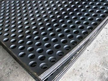some pieces of round hole perforated stainless steel sheets are ...