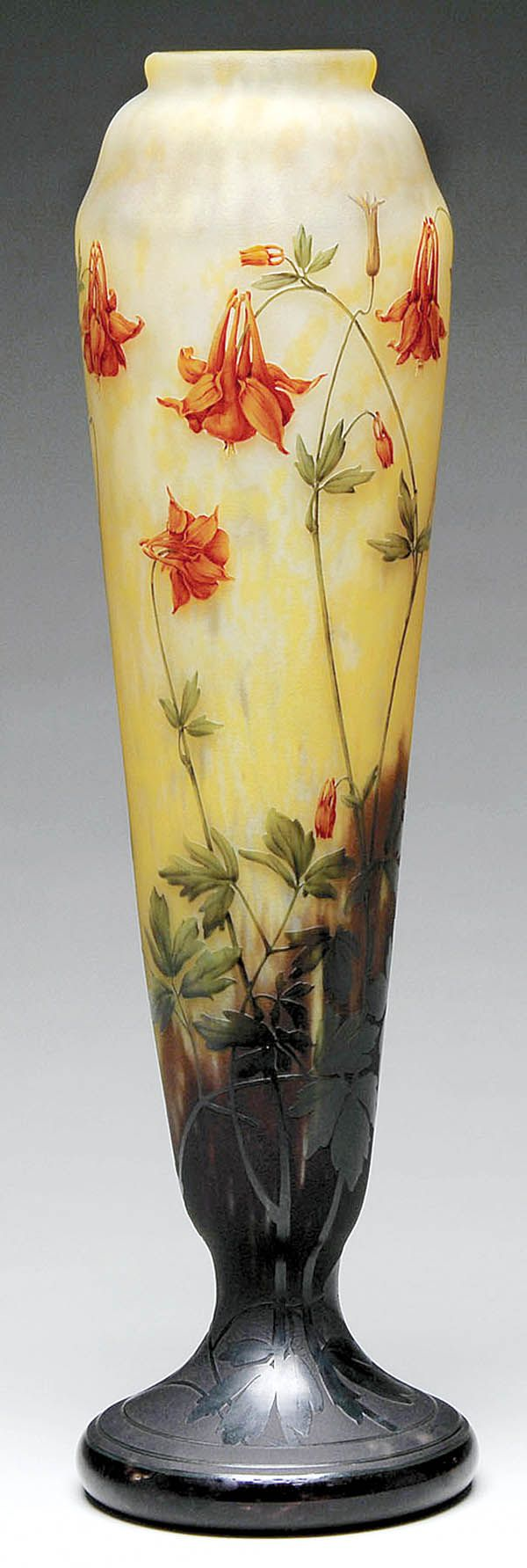 Daum Nancy cameo and enamel vase decorated with rich red columbine flowers.