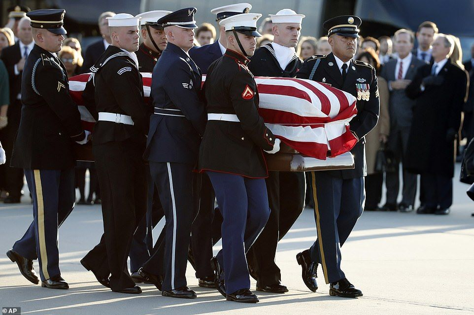 HW Bush's remains arrive to lie in state in the