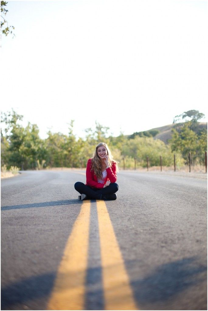 cute senior girl pose on the road