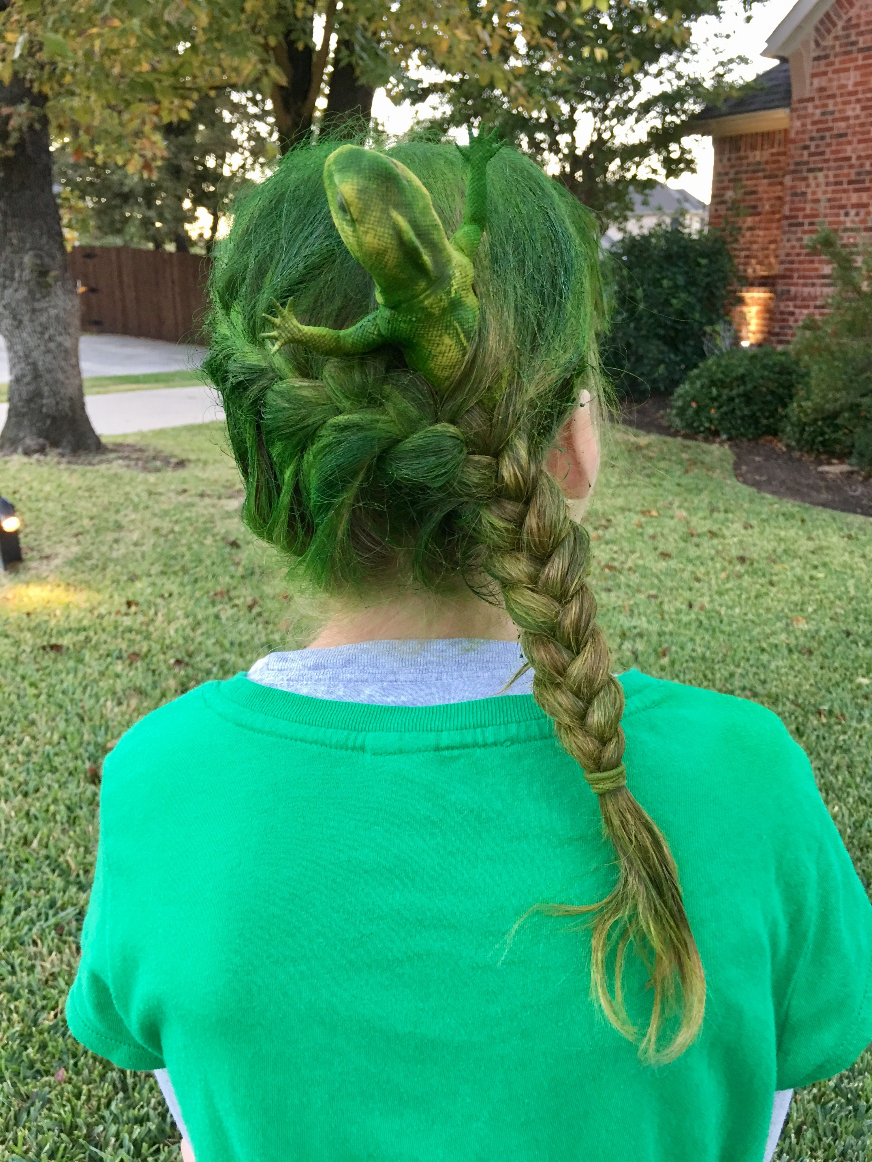 crazy hair day at school. french braid holding rubber lizard