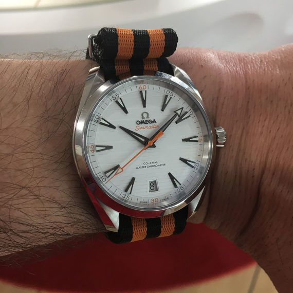 "9c779efa806 The Omega Aqua Terra Golf watch with orange and black striped NATO strap is  devoted to Omega s professional golf ""ambassador"