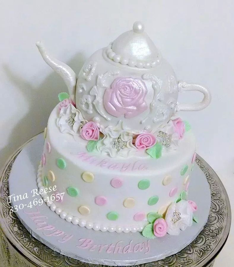Teapot made out of rkt and covered in fondant Ribbon roses and