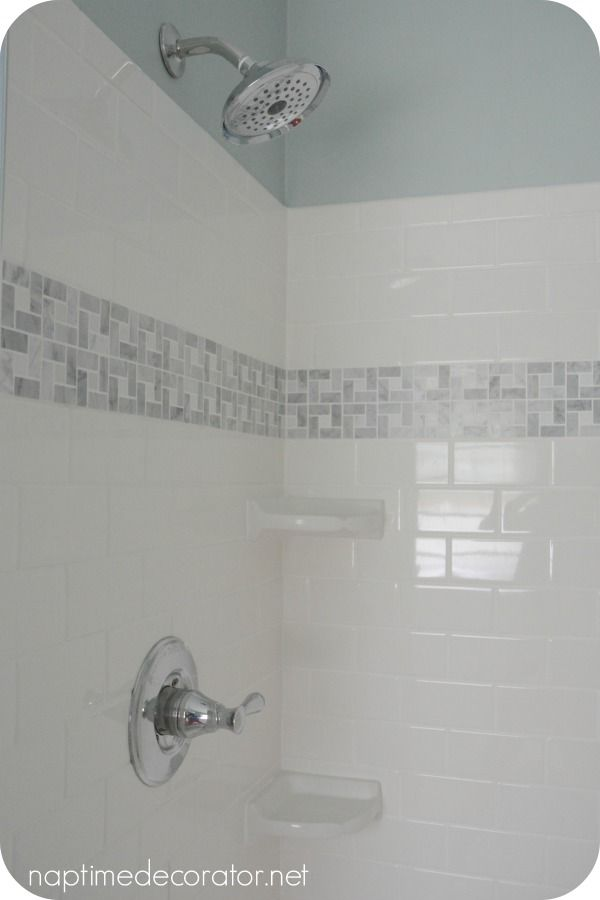 wall paint: Sherwin Williams Rainwashed white vinyl beadboard on the bottom white subway tile with an accent strip of marble and 2 small corner shelves
