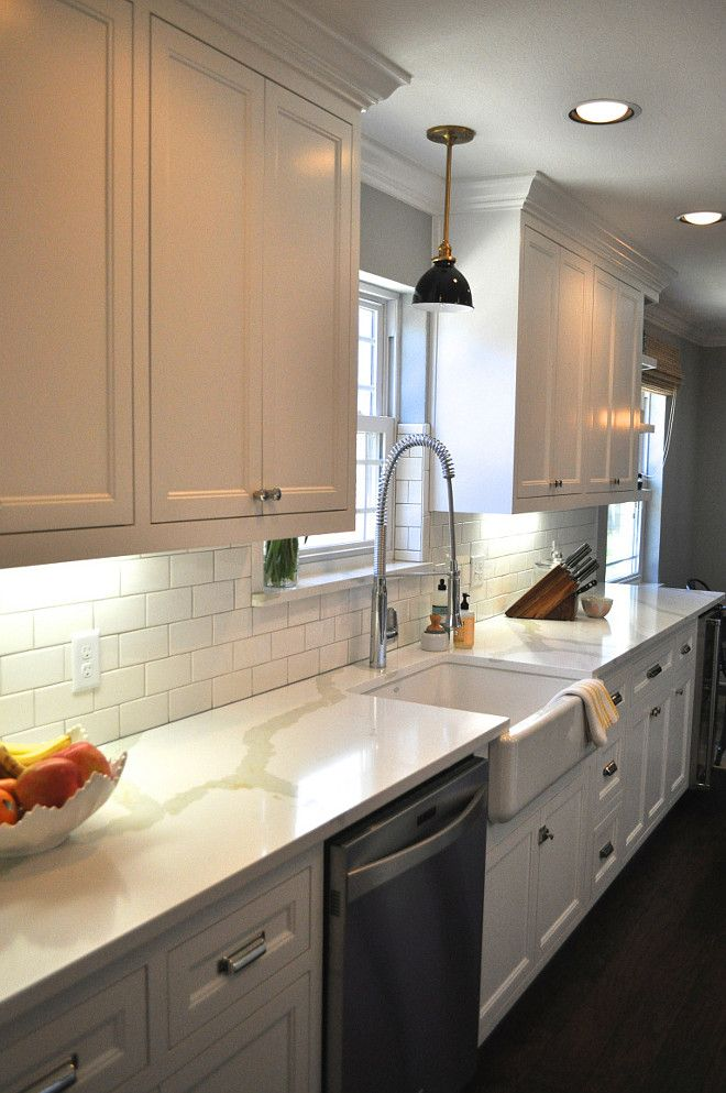 benjamin moore snowfall white oc-118. kitchen cabinet painted in