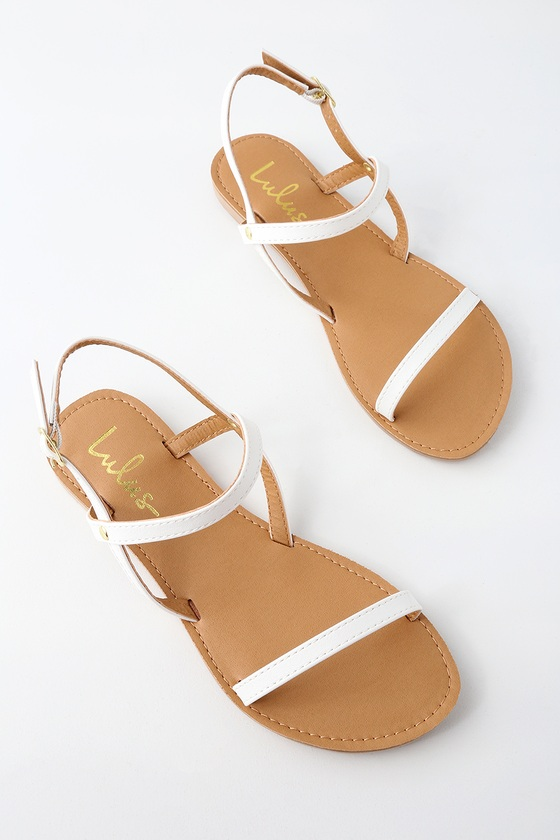 With the Rika White Flat Sandals