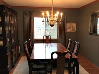 Classic pleated drapery panels in this traditional dining room. #windowtreatments #diningroom