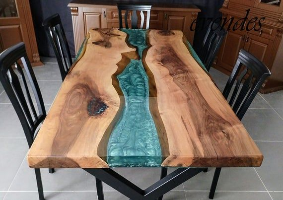 ** Welcome to our store ** This epoxy table has been sold. If you want a similar project, please contact us. This table is made of green, turquoise and white epoxy resin and walnut wood. The color of the epoxy resin can make all the colors you want The feet are made of black model. Foot models