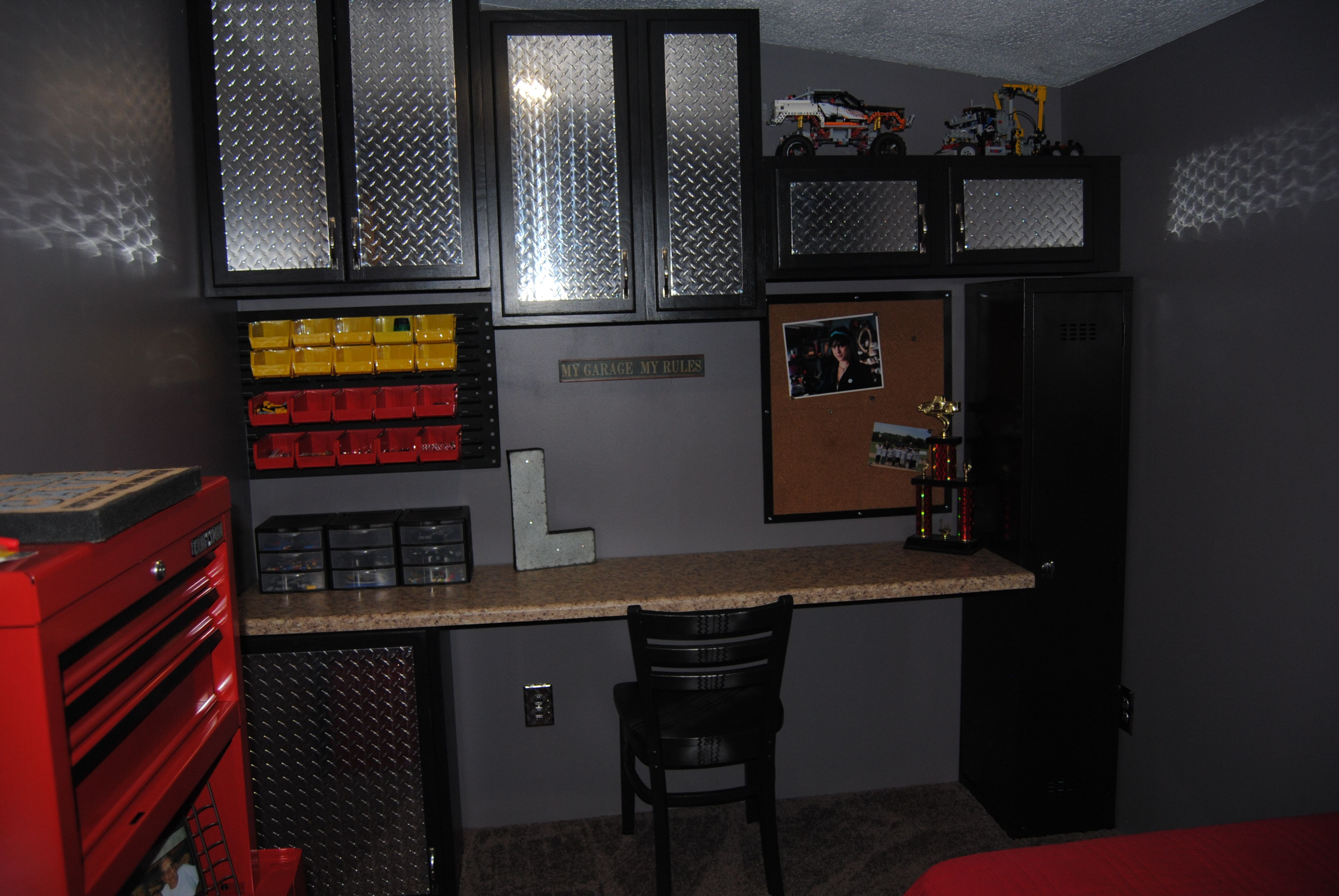 refurbished kitchen cabinets painted black with cut diamond plate
