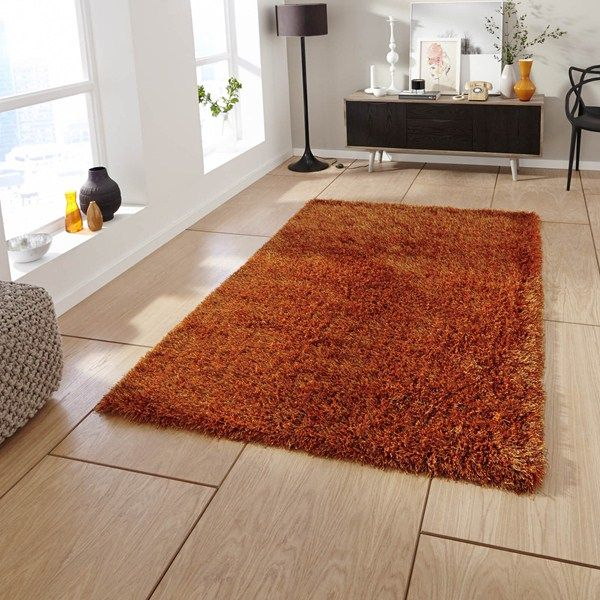 Monte Carlo Shaggy Rugs In Burnet Orange Are Hand Made China From Polyester And Acrylic With Thick Thin Yarns