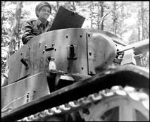SPAIN. Late May early June 1937. Republican soldier in a tank, Navacerrada Pass, Segovia front.
