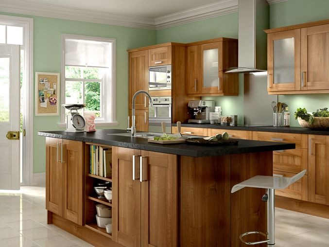 stunning kitchens walnut cabinets | Beautiful walnut cabinets and cool green walls make this ...