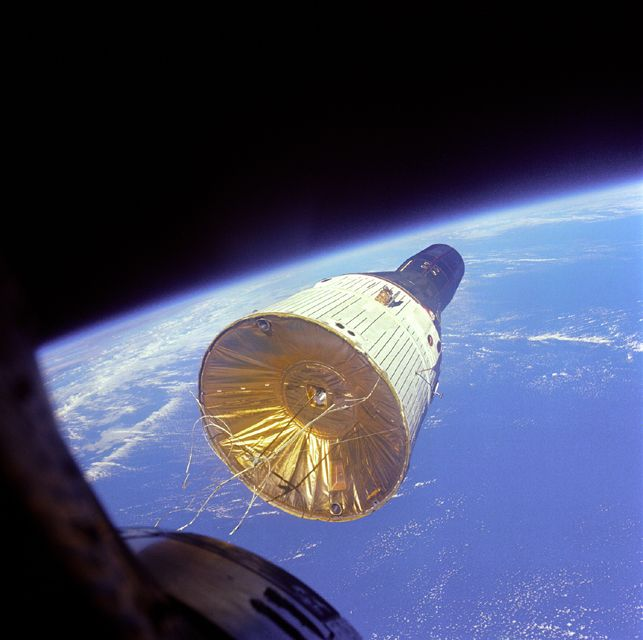 December 15, 1965: Gemini VI-A view of Gemini VII in orbit 160 miles (257 km) above Earth during first space rendezvous. Photo credit: NASA