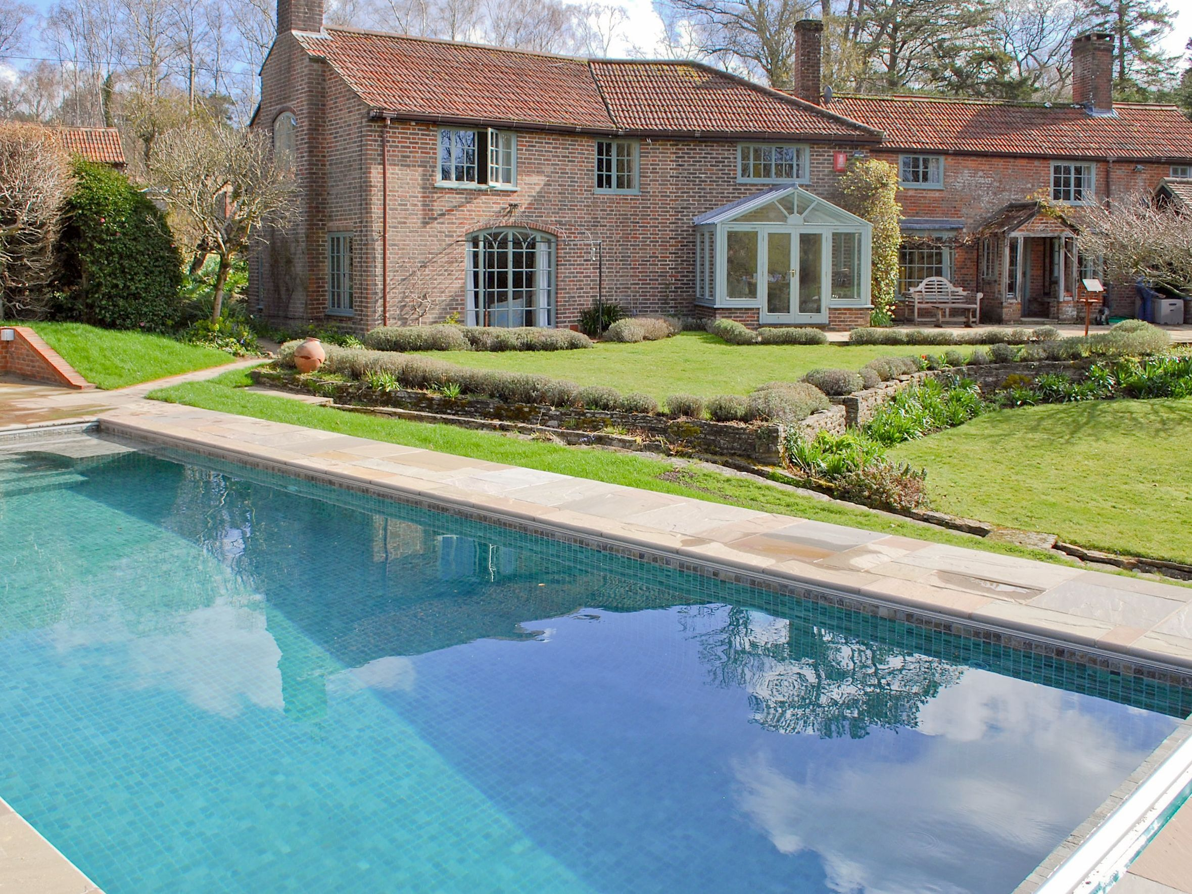 Within The Beautiful Gardens Sits A Tiled Outdoor Heated Swimming Pool With Elegant Roman End And Shallow Ste Cottages With Pools Cottage Rental Vacation Home