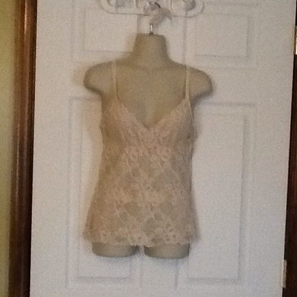 Banana Republic Lace top Tan lace top with lining.  adjustable straps.  17 inches long from bottom of strap.  Made in Srilanka 90% nylon and 10% spandex.  Lining is 92% polyester and 8% spandex.  short top. Banana Republic Tops