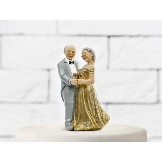 Trouwfiguurtje gouden jubileum. Echtpaar trouwfiguurtje voor een gouden jubileum. Het trouwfiguur is ongeveer 12 cm groot.