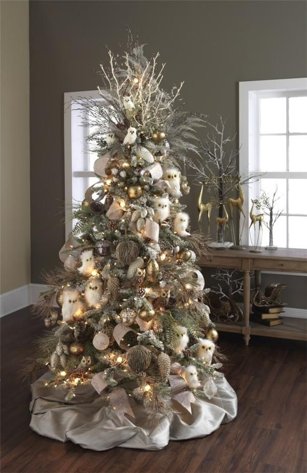 designer decorated christmas tree filled with white owls brown owls pine cones and other woodsy themed christmas ornaments