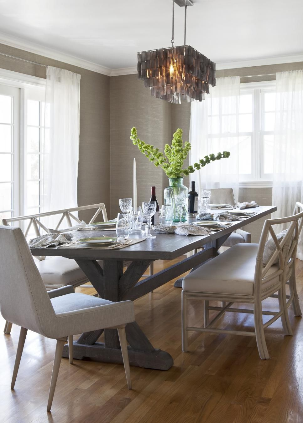The Focal Points Of This Inviting Dining Room Are The Modern Style