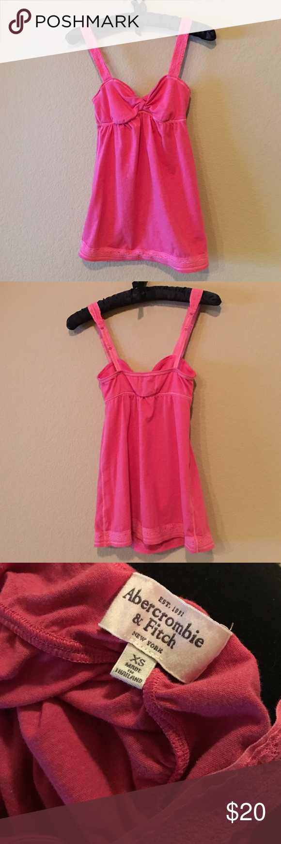Abercrombie & Fitch pink tank top Cute Abercrombie & Fitch pink tank top with lace trimmed front straps and hem, twist front. Adjustable straps. Price is firm. Abercrombie & Fitch Tops Tank Tops