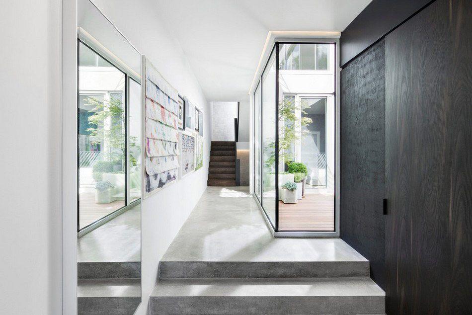 Moderne villa met grote glaspartijen betonnen trap mijn stijl