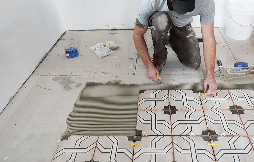 How To Install Floor Tile And Grout Room For Tuesday Floor Installation Patterned Floor Tiles Tile Floor