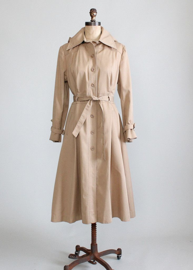 Vintage 1970s princess cut trench coat with detachable hood.