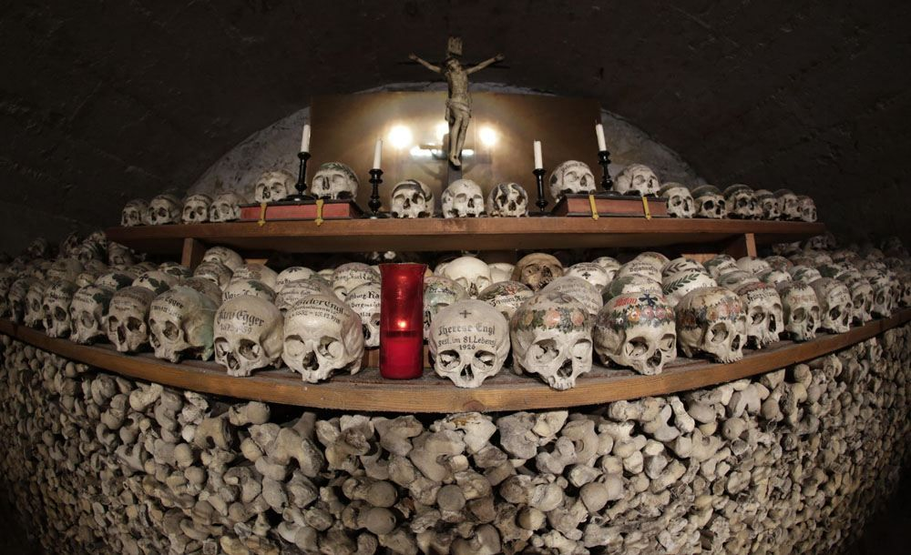 Human Skulls Adorned With A Crown Of Flowers And The Name And Date Of Its  Owneru0027s Death Are Placed In Rows At The Bone House In Hallstatt, Austria.