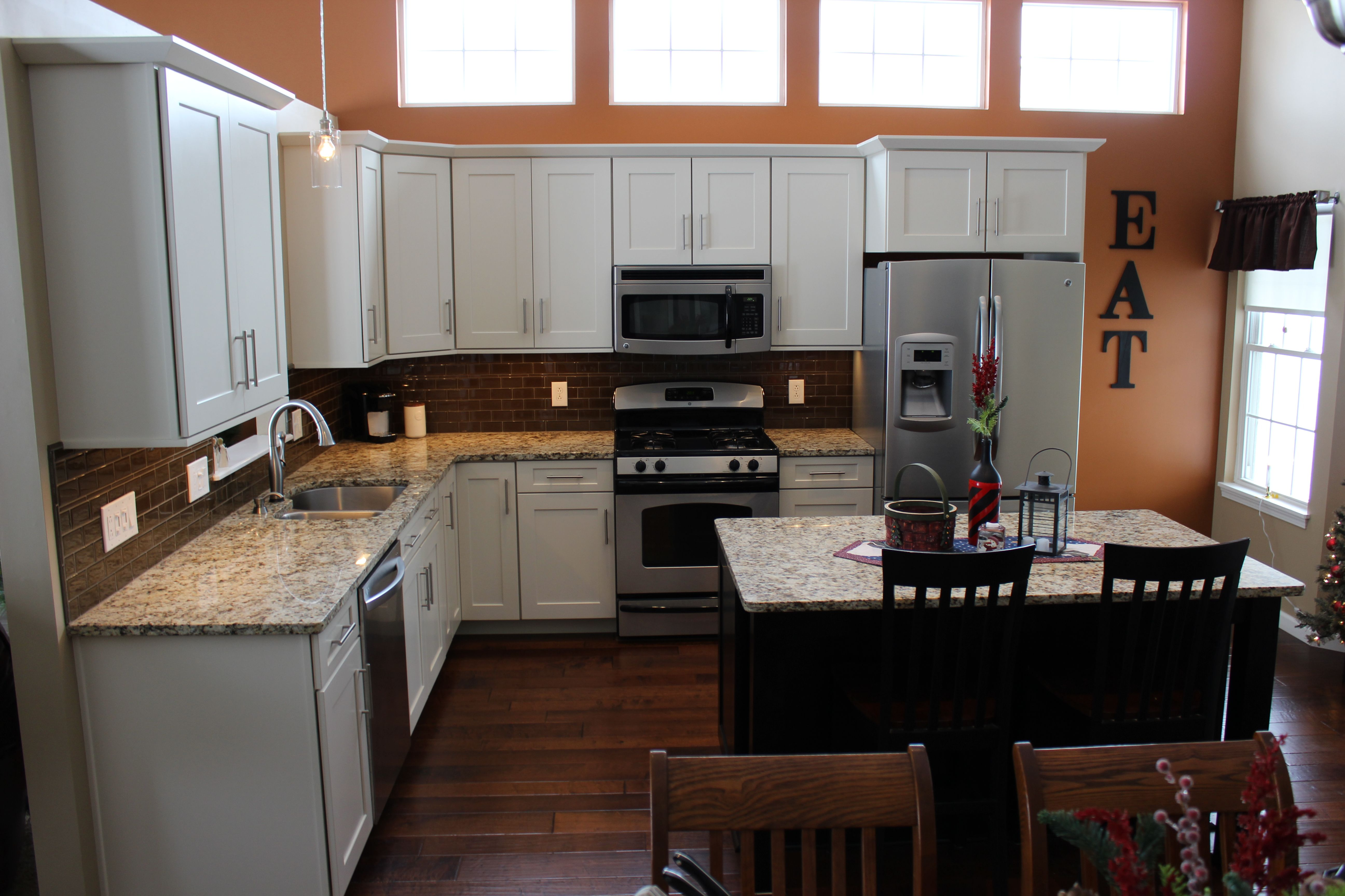 installing the glazing kitchen cabinets. This Kitchen Was Remodeled With Waypoint 650F Maple Cabinets In Cream Glaze Installed On The Perimeter And Espresso For Installing Glazing E