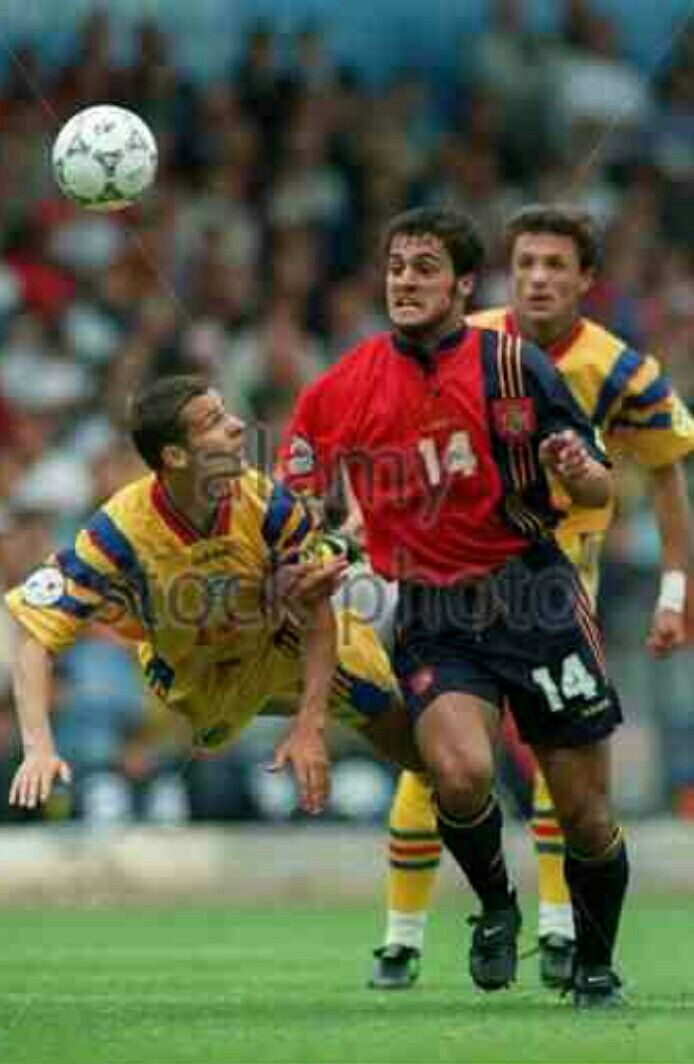 Spain 2 Romania 1 in 1996 at Elland Road. Tibor Selymes heads the ball away from the advancing Kiko in Group B at Euro '96.