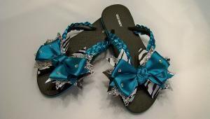 Cute Flip Flops cheer team colors.   Do not walk around comp hotel pools, floors barefoot.