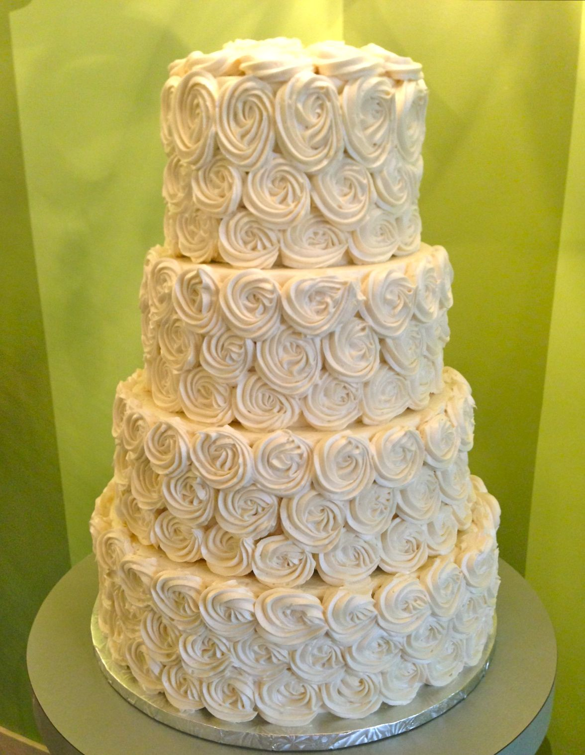 3 tier wedding cakes with buttercream blossoms