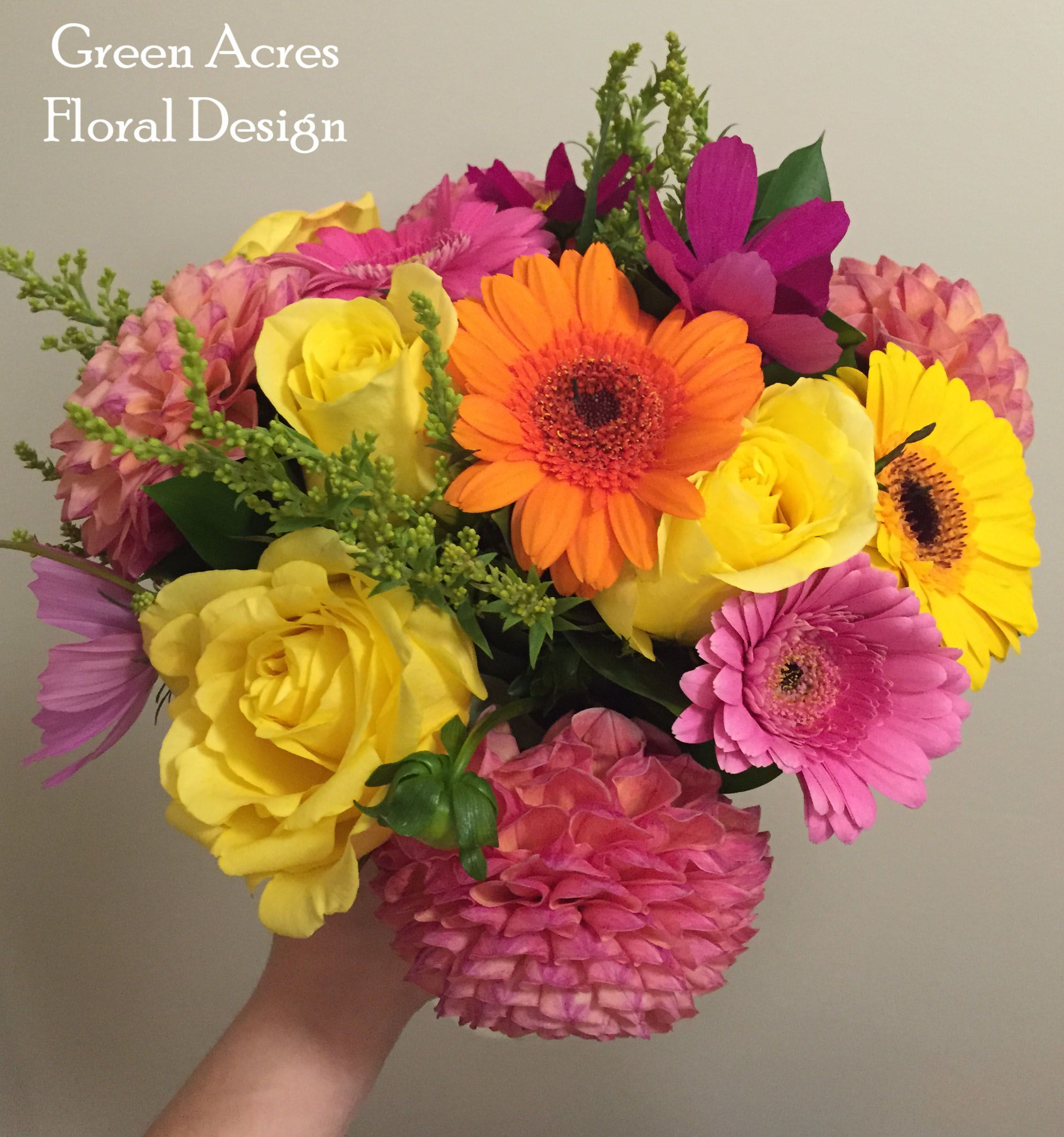 A bright and summery floral arrangement of dahlias roses cosmos a bright and summery floral arrangement of dahlias roses cosmos and gerbera daisies reviewsmspy