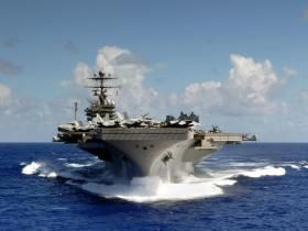 USS Abraham Lincoln christened and launched February 13, 1988.  Motto:  Shall Not Perish.
