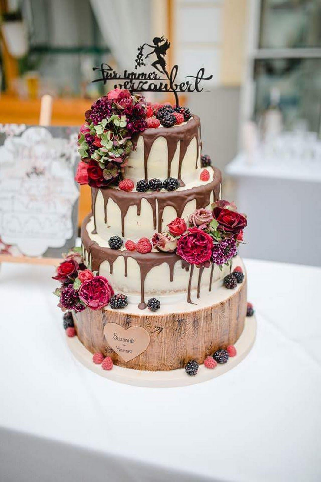 Semi Naked Wedding Cake with fresh flowers and berries
