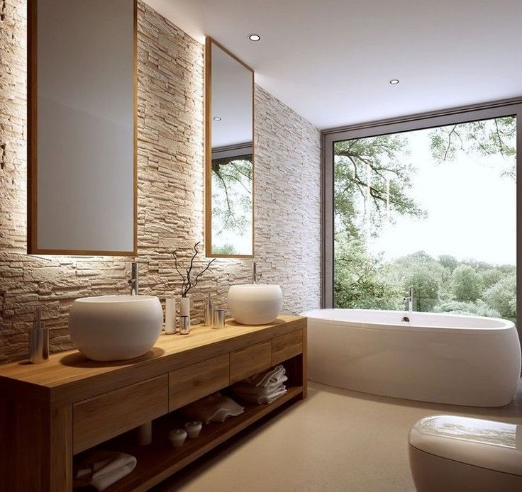stone wall behind 2 backlit vanity mirrors wood and bowl sink counters drawers and shelf option allow for open feeling simple window frame can be treated - Luxus Hausrenovierung Doppel Waschbecken Design