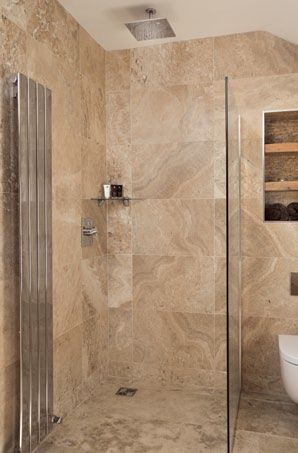 A stunning rainfall shower from Grohe creates a spa-like corner in ...
