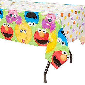 This Elmos 1st Birthday Tablecover Features An All Over Polka Dot Background With Sesame Street Characters