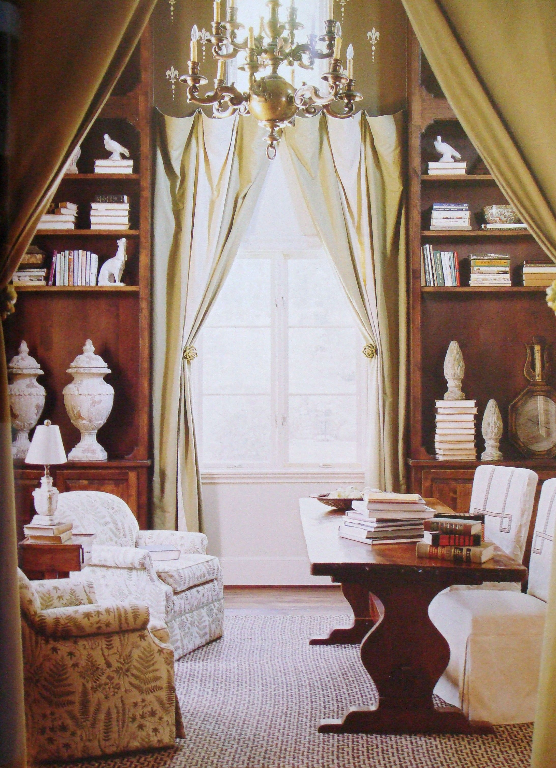 Tall bookcases and flowing draperies match the drama of the 20-foot high ceiling; interior design by Edwina Alexis (via Country French Magazine, Spring/Summer 2011) #books #bookshelves #home_library